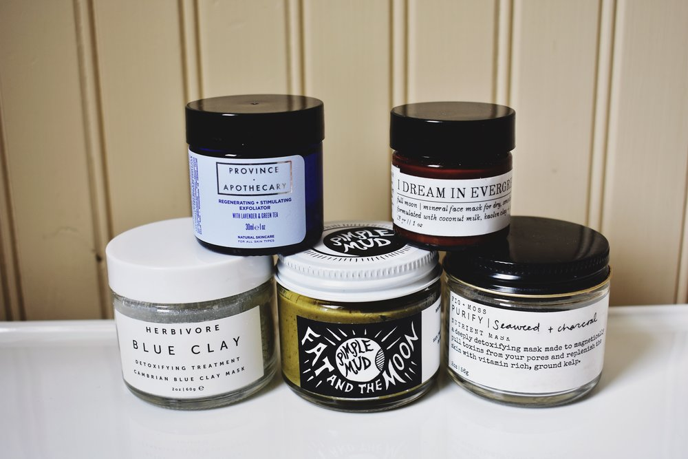 Left to right: Herbivore Botanicals Blue Clay Mask, Province Apothecary Stimulating Cleansing Grains, Fat and the Moon Pimple Mud, I Dream in Evergreen Full Moon Face Mask, and Fig & Miss Purify Mask.