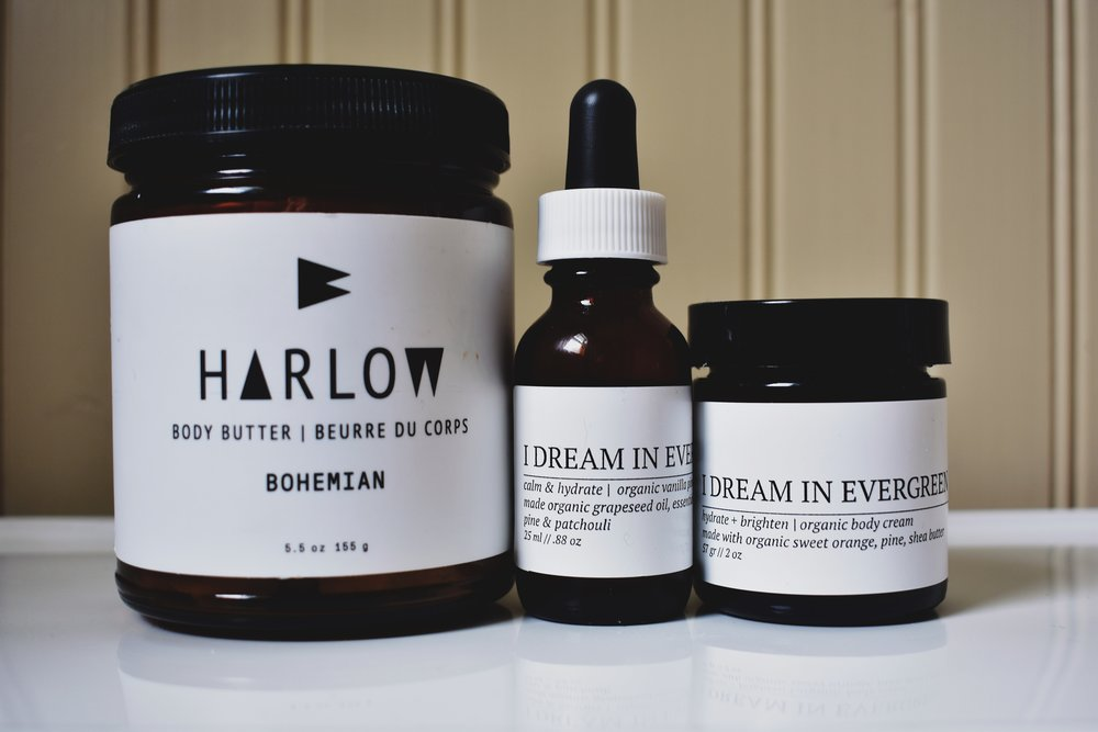 Left to right: Harlow Skin Co. Bohemian Body Butter, I Dream in Evergreen Vanilla Pine Body Oil, and I Dream in Evergreen Orange Pine Body Cream.