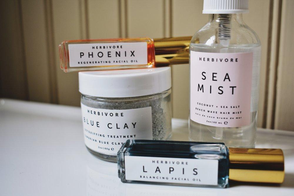 Left to right: Herbivore Botanicals Phoenix Facial Oil, Blue Clay Mask, Lapis Facial Oil, and Coconut + Sea Salt Sea Mist.