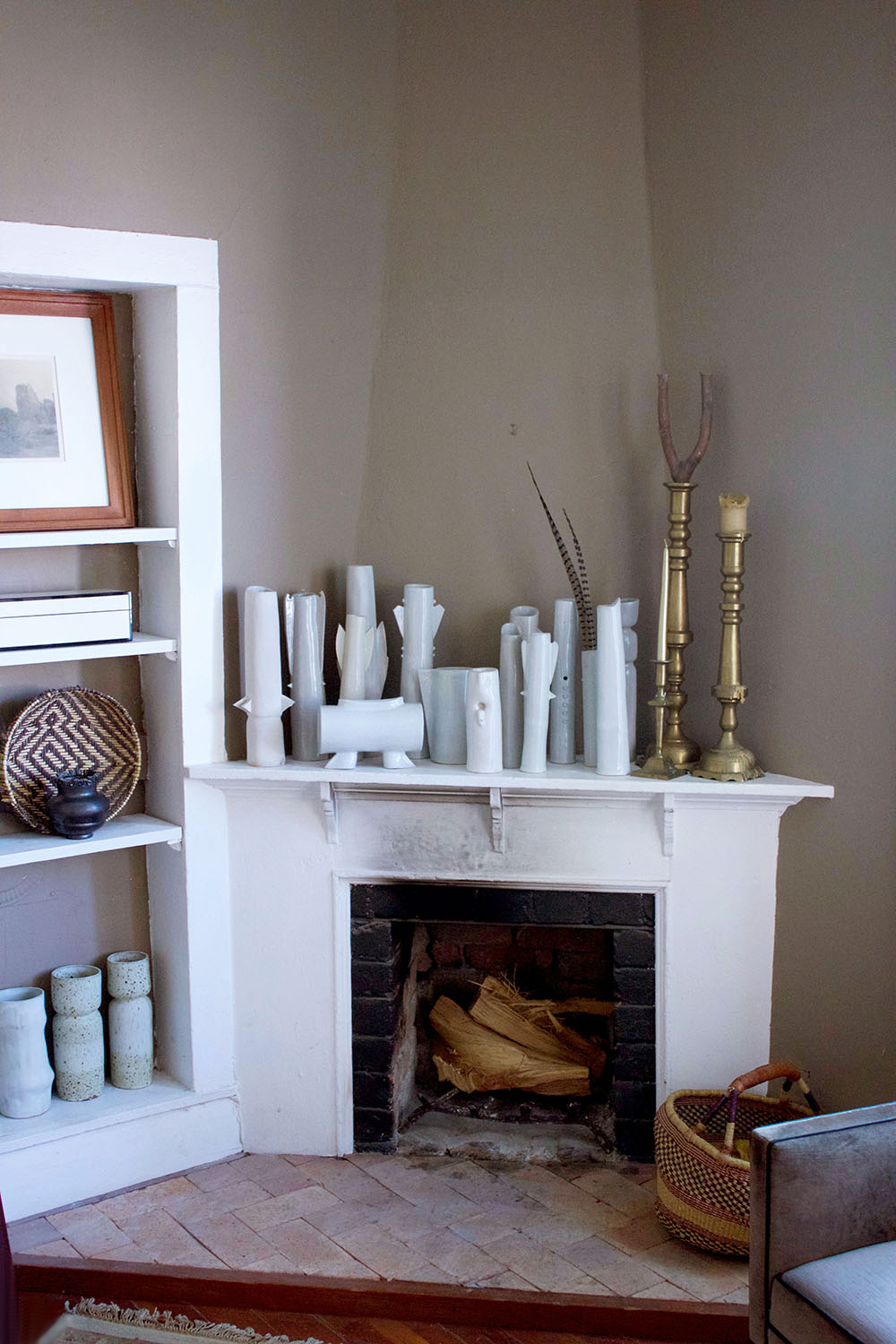 A collection of Amanda's most treasured hand-made ceramic vessels grace the fireplace mantel.