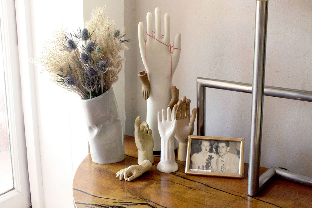 More hands and favorite photos of Amanda's grandparents create an intimate display on the bedside table.
