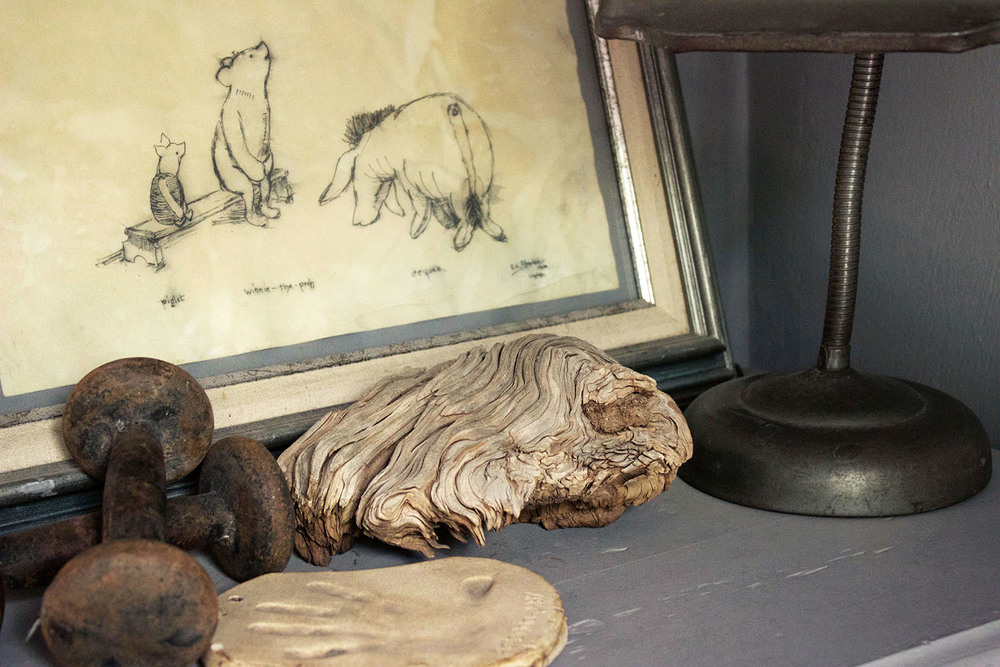A sketch of Winnie the Pooh by her father's stepfather, a task lamp from her father's old office, and other sentimental treasures brighten a corner of Amanda's adobe.