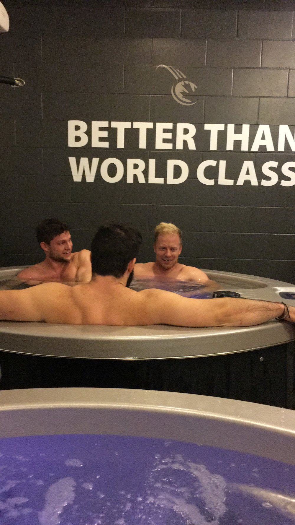 The boys hitting the recovery tubs after sliding.