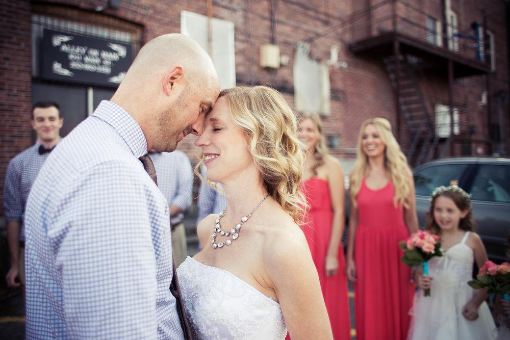 Sumner Washington Wedding, bridal party with bride and groom and brick