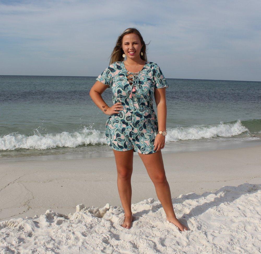 Alyssa representing SRB at the beach in her Show Me Your Mumu romper!