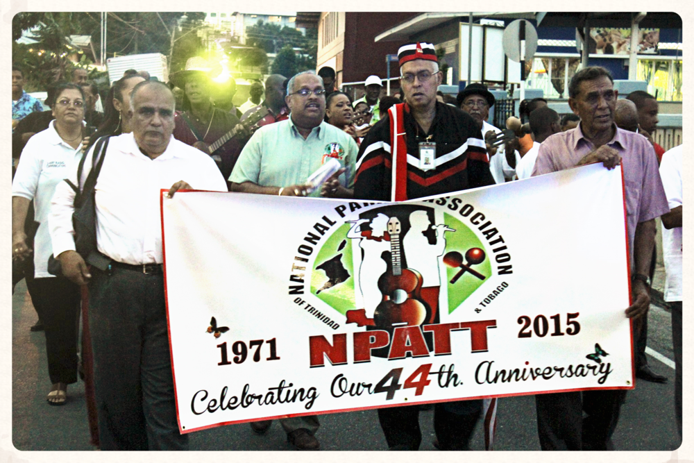 Members of NPATT parade with fellow supporters to commemorate the 44th anniversary. (2015). Banner bearing the former NPATT logo.