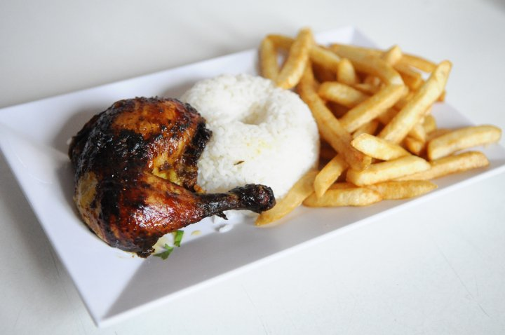 Pollo a la Brasa con Arroz y Papitas Fritas!-Rotisserie Chicken with a side of rice and Fries.jpg