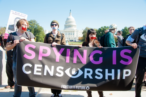 Protesters rally against mass surveillance during an event organised by the group Stop Watching Us in Washington, DC on October 26, 2013