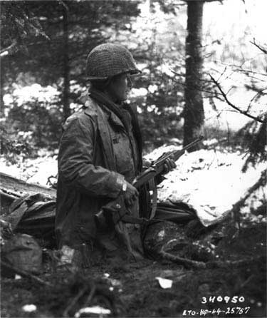 A 442nd RCT squad leader checks for German units in France in November 1944.