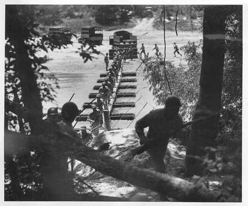 The 442nd in training building then attacking across a pontoon bridge at Camp Shelby