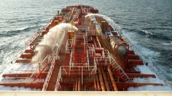 Ship using fire hoses to fight off Somali pirates