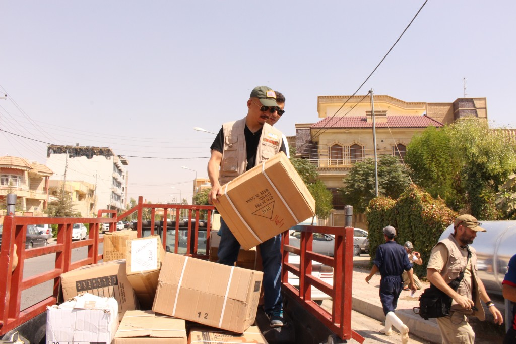 A Bongo full of Humanitarian Aid supplies being unloaded by DVM D.A.R.T. team members in Iraq Kurdistan