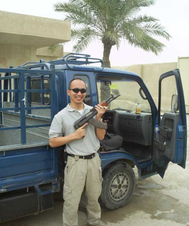 "James ""ARCHER"" Price in Iraq next to a Bongo used to drive around Baghdad lo-pro"