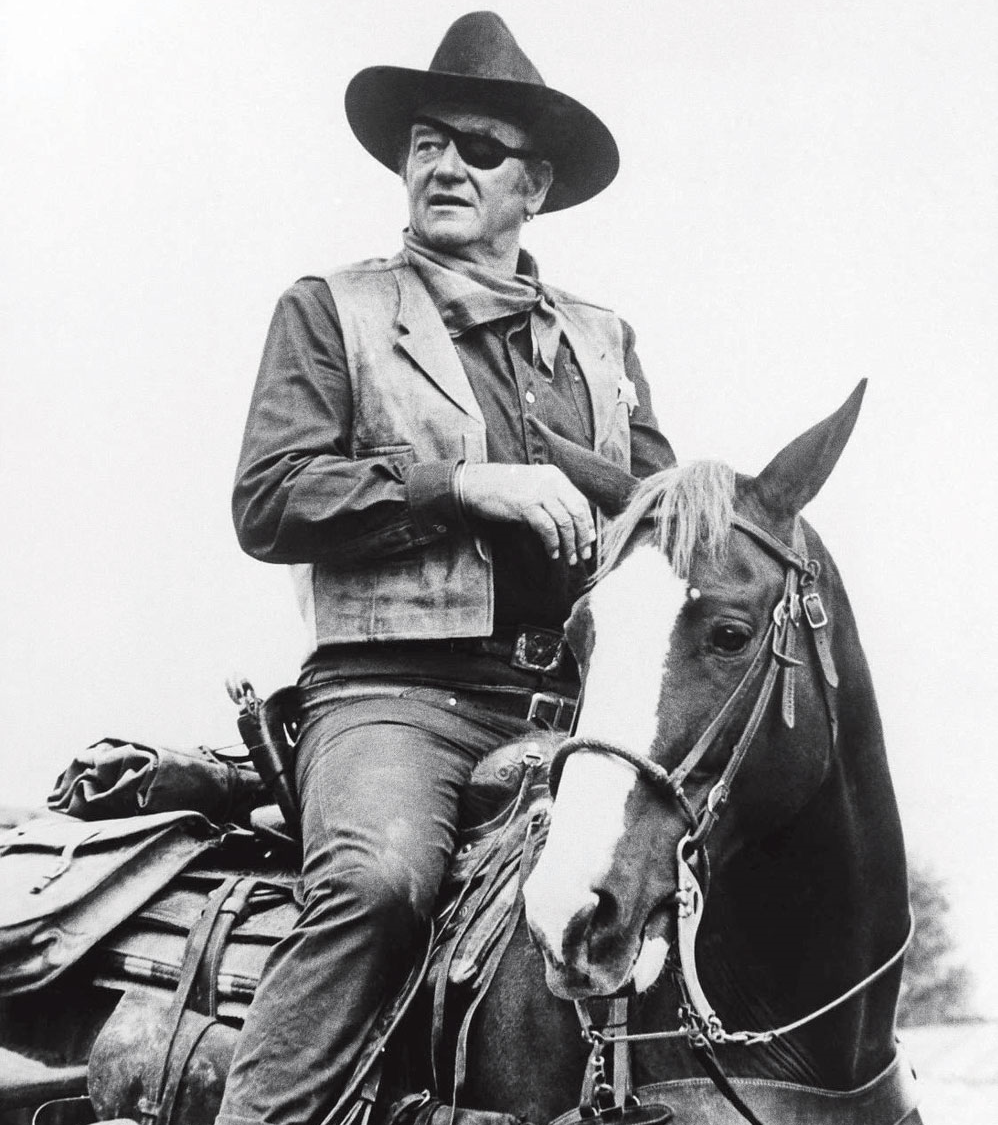 John Wayne would kick your teeth in if he saw you wearing a gun on a nylon belt