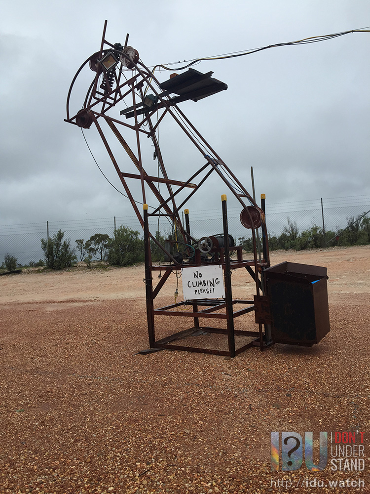 An automatic hoist, ordinarily used to lift opal dirt from below ground to a truck on the surface, has been repurposed as a projector stand for the 2016 presentation of  Spark , a multimedia video presentation about the Lightning Ridge experience, culture and lifestyle.