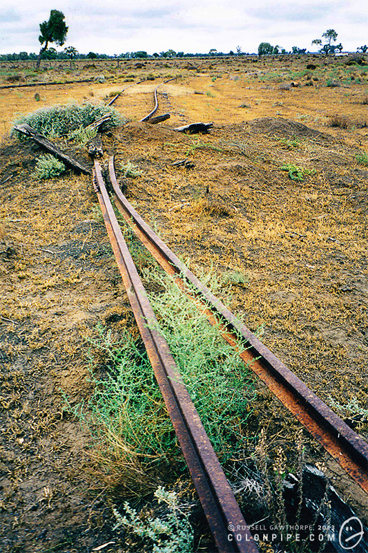 Some of the old lines have been plowed up, resulting in a tangled mess of steel. (2002.)
