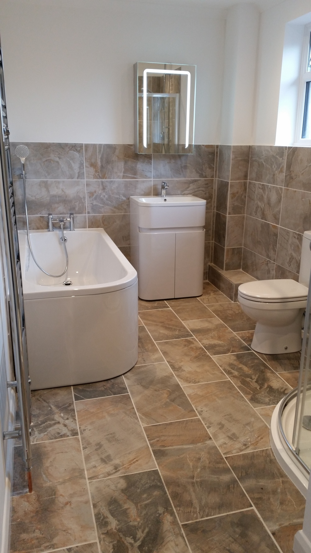 . . . we complete bathroom renovations also.