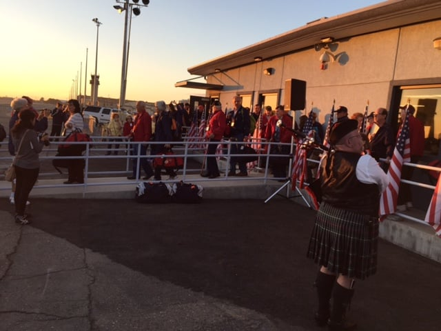 A grateful crowd wishes the Central Valley Honor Flight participants a safe trip.  Photo by Vaune Newvine