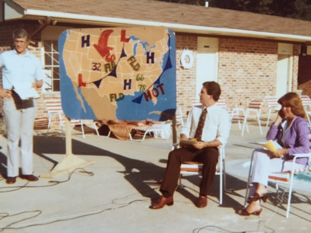 While live on-the-scene reports were common on local television stations in the early 1980s, moving the entire news anchor team on location was a relatively new trend.  Pictured are WAAY weather man Bob Baron, anchor Jim Marsh and the late Helen Howard in a newscast dedicated to summer recreation.  Photo from the Newvine Personal Collection.