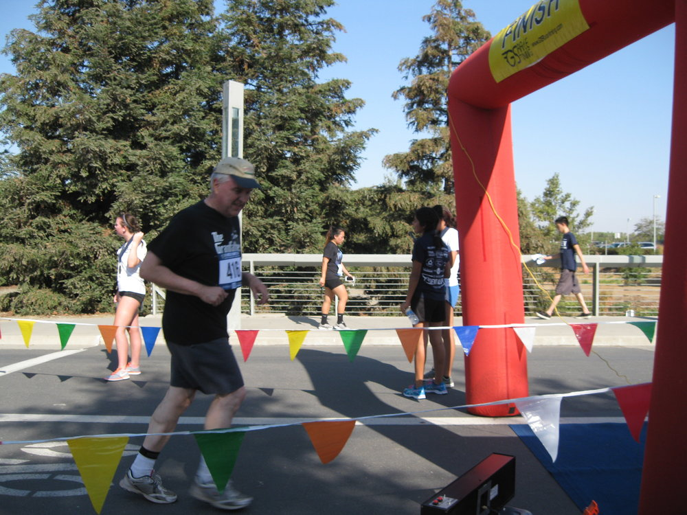Crossing the finish line at the UC Merced Journey 5-K in September 2016.  Photo from the Newvine Personal Collection