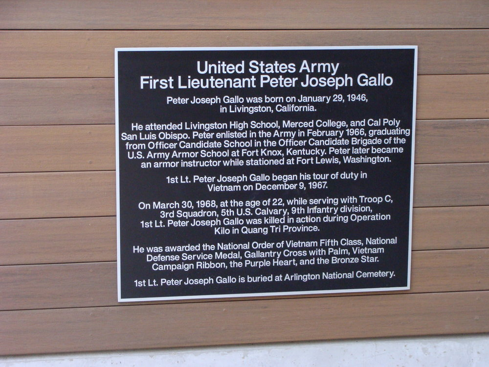 Plaque behind the entrance sign at the First Lieutenant Peter Joseph Gallo Veterans Resource Center at Merced College.  Photo by Steve Newvine