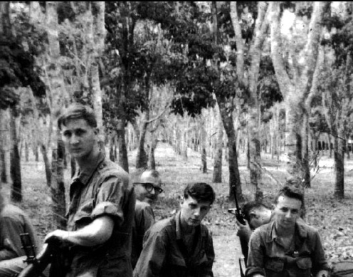 Bill Newvine didn't seek the spotlight or even the camera's lens in this photo from his time in Vietnam.  He's the soldier wearing glasses. Photo: Alpha Association