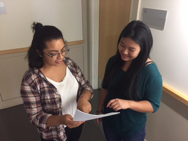 UC Merced interns Rose and Diana are learning from one another as well as learning from their students in the Summer Enrichment Program of the Harvest Park Educational Center.  Photo by Steve Newvine