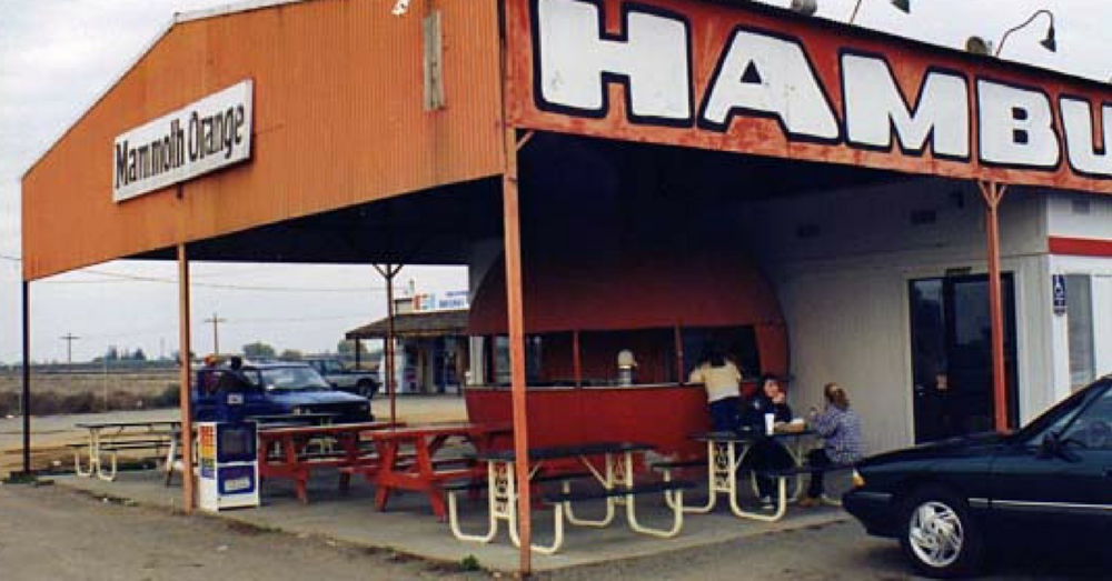 A vintage photograph of the locally famous Fairmead Orange Stand on Highway 99.  The stand closed about ten years ago. Photo: GoFundMe.com/mammothorange