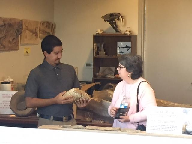 A Fossil Discovery Center volunteer shows an exhibit to a visitor. Photo: Steve Newvine)