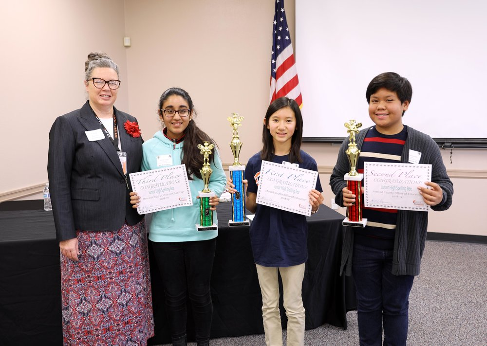 Junior High Spelling Bee Wordmaster Audry Garza, a coordinator at MCOE, poses with third place winner Samika Judge, first place winner Nicole Nguyen and second place winner Luke Almeada. Photo: Nate Gnomes, Merced County Office of Education