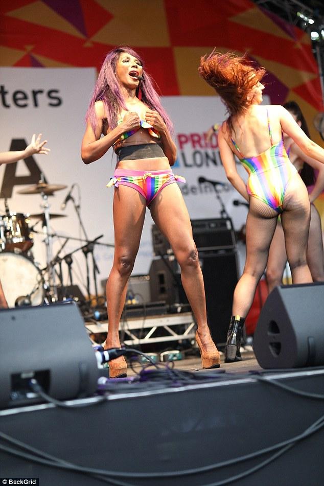 Energetic:Sinitta, 54, exhibited her flawless figure in a barely-there rainbow bikini