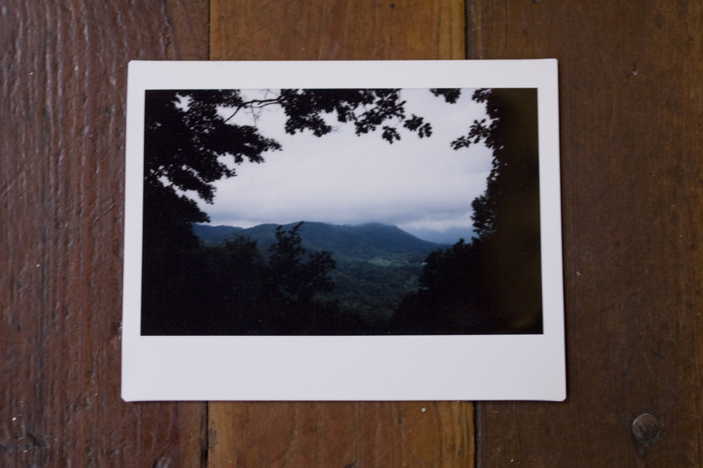 """americanguide :       GREAT SMOKY MOUNTAINS, NORTH CAROLINA     Guide to North Carolina Brittany Kearns logs a report for Field Assignment #1: Topography and Climate , on how the Great Smoky Mountains got their name:     The Cherokee Indians have many legends about this area, which was part of their former home. Origin of the name Great Smoky is buried in obscurity, but it was probably suggested to Indians or early settlers by the tenuous mist, a dreamy blue haze like that of Indian summer, or deeper that hovers almost always over the high peaks. Earliest official Government use of the term is in the 1789 act of cession delimiting the boundaries of North Carolina and what is now the State of Tennessee: """"… thence along the highest ridge of said mountains to the place where it is called Great Iron or Smoky Mountain.""""   — North Carolina: a guide to the old north state  (WPA, 1939)       * * *        Brittany Kearns  is a Guide to North Carolina. An honorary Southerner, she was born in New Jersey, but now calls rural Chatham County home. She's got a degree in anthropology, a love for documentary photography and takes film over digital any day. Follow heron Tumblr at thebeekearns.tumblr.com and check out her portfolioat BrittanyKearns.com .       i'm just over the border, but i've had this state on my mind a lot lately. from past lives & future ones."""
