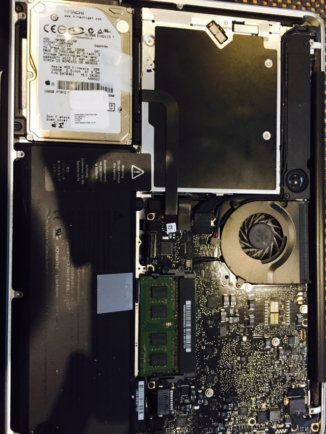 Taking the base off the macbook to remove the hitachi hard drive