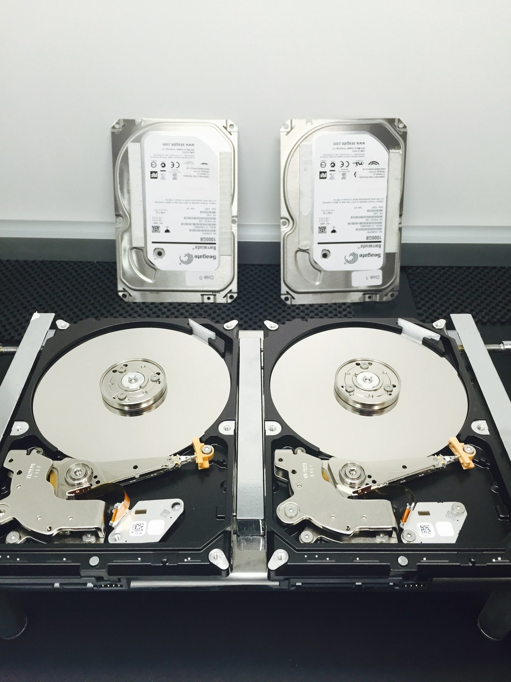Seagate St1000dm003 drives opened up in the cleanroom awaiting head swap