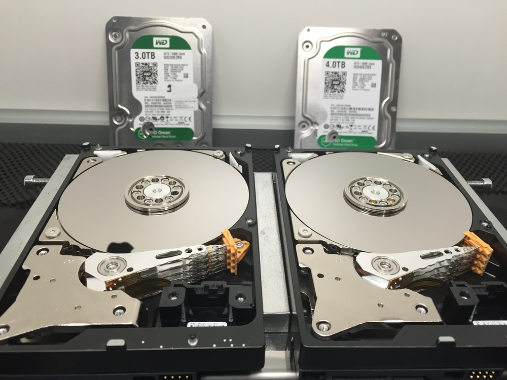 Our 3TB and 4TB open and ready for head swap, drive on the right is the faulty one but it looks fine after being dropped, no marks that i can see.
