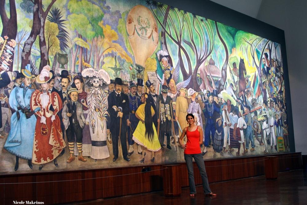 """Nicole in front of Diego Rivera's """"Sueño de una Tarde Dominical en la Alameda Central"""""""
