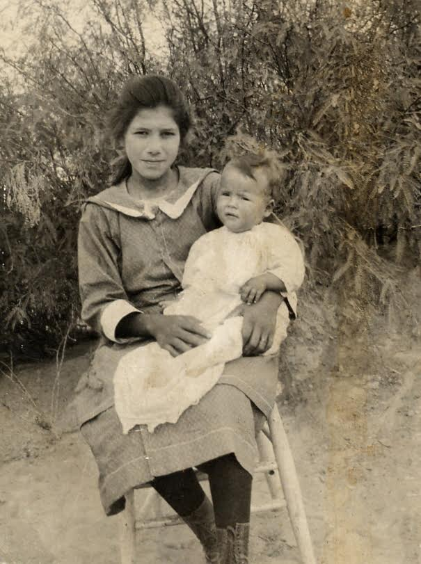 Yvette Marquez-Sharpnack's grandmother Jesusita,at age 14,holding her little sister Pola.                    (Photo Courtesy: MuyBuenoCookbook.com)