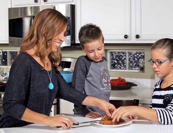 Yvette cooking with her children. (Photo Courtesy: MuyBuenoCookbook.com)