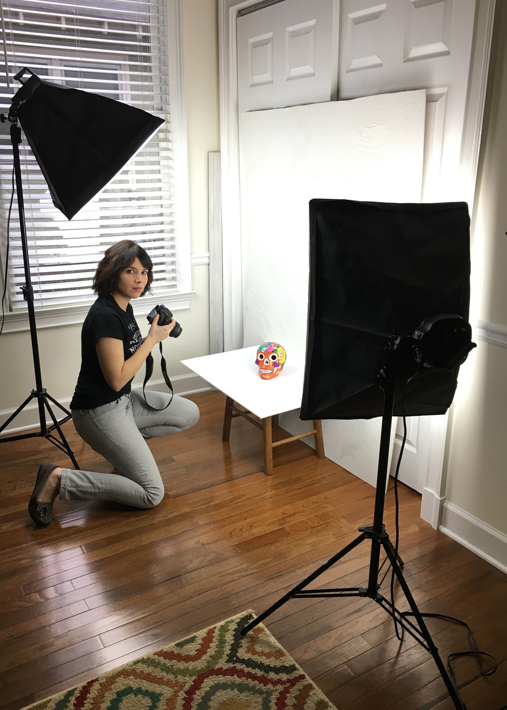 Angelique snaps pictures of merchandise for her website at home. (Photo Courtesy: Angelique Sloan)