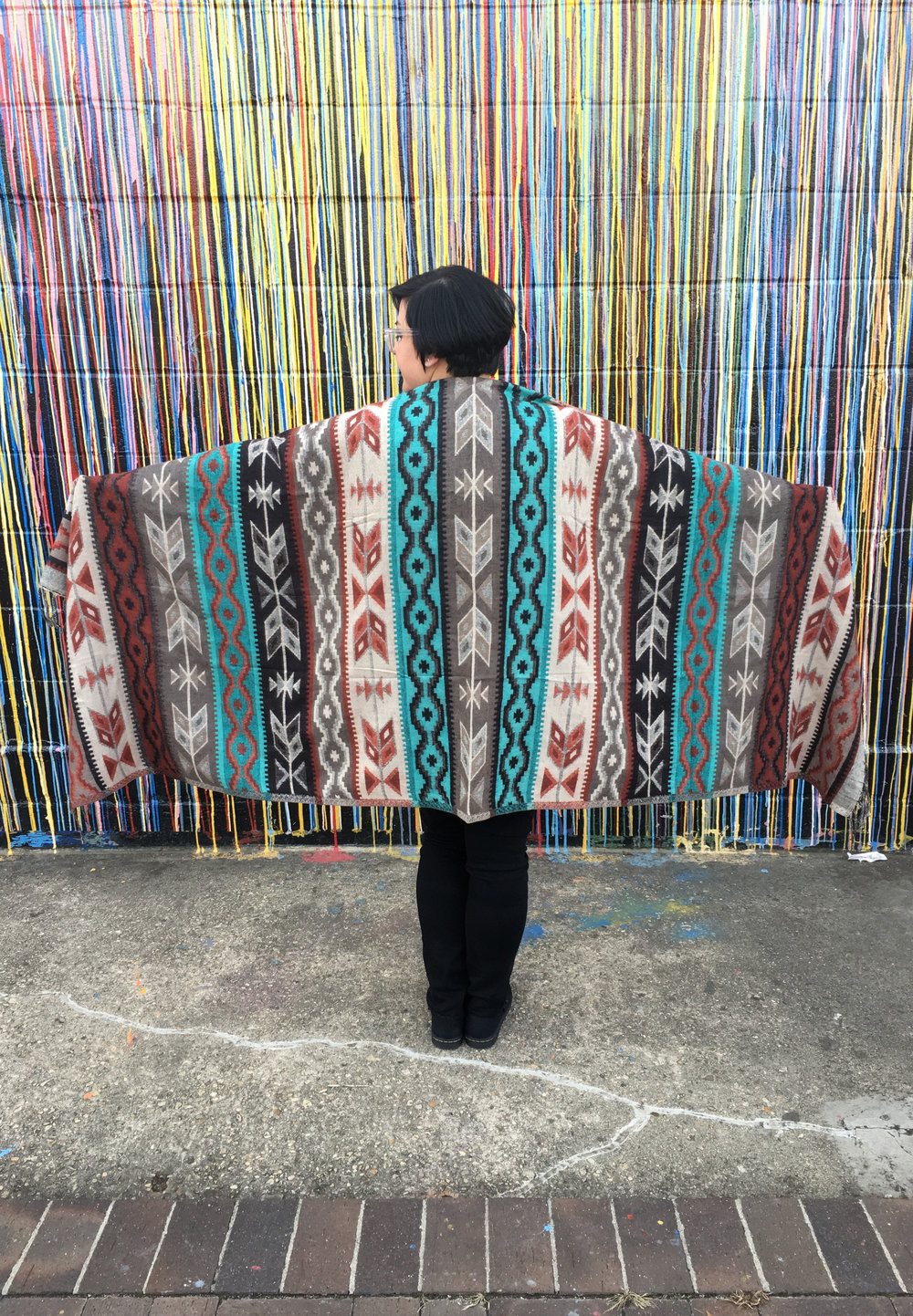 Gina, Angelique's sister, models a Southwest-style shawl. (Photo Courtesy: Angelique Sloan)