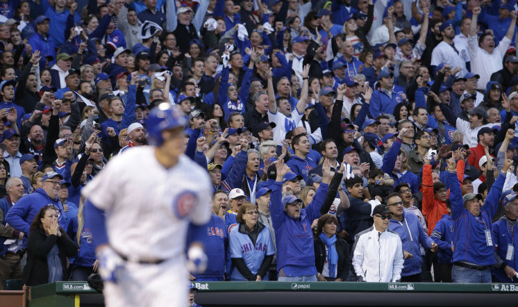 Fans cheer as Chicago Cubs' Anthony Rizzo (44) hits a home run against the St. Louis Cardinals during the sixth inning of Game 4 in baseball's National League Division Series, Tuesday, Oct. 13, 2015, in Chicago. (AP Photo/Nam Y. Huh)