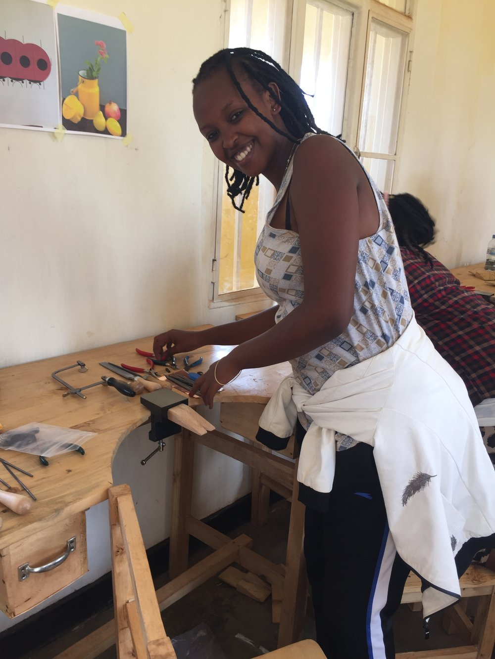 """Sandrah Uwasa Sandrah is a 22 year old metalsmith who graduated from Secondary School in Nyamata with a degree in Tourism. Sandrah is thrilled to be apart of Abari and express her true passions of jewelry, fashion and expressing creativity. Sandrah aspires to be an excellent jewelry artist, representing her country and her village. Sandrah says, """"I will always remember who helped me so when I have the ability it'll be my turn to help young girls in my community."""""""
