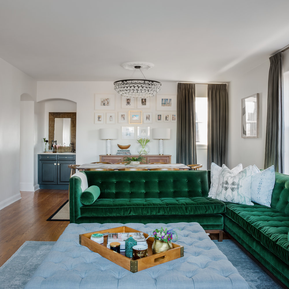 sofa  //  ottoman  // tray ( similar ) //  light fixture  // picture frames