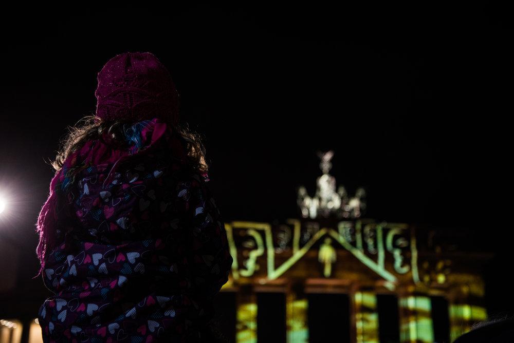 girl watching brandenburger tor lights (1 of 1).jpg