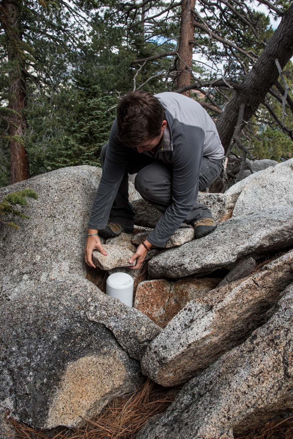 Kim securing the peak can in some rocks