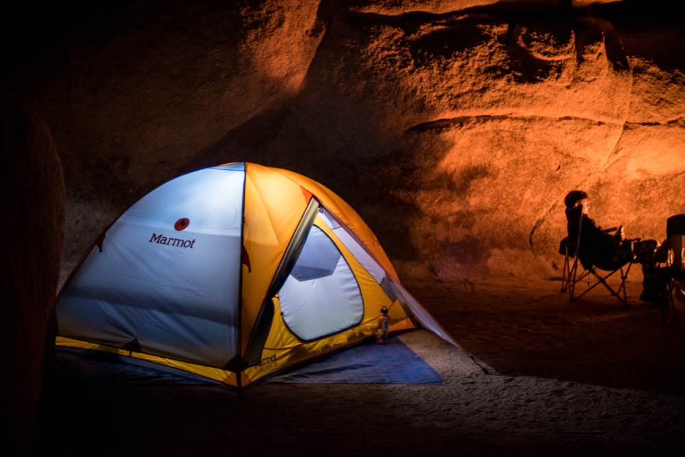 Tent with fly, illuminated by LuminAID PackLite 16 solar lantern.