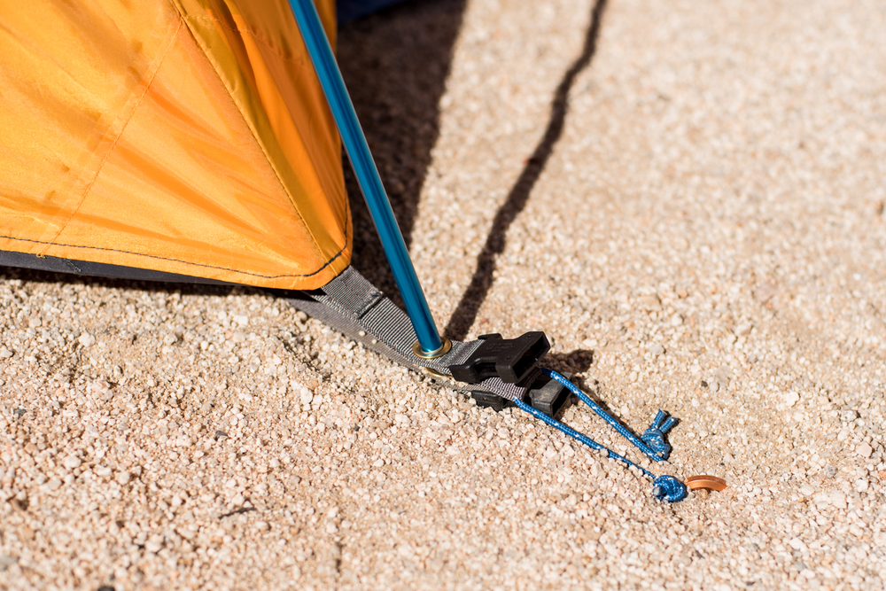 This shows the staked tent and footprint, with the plastic connection for the rain fly. It just clips on.