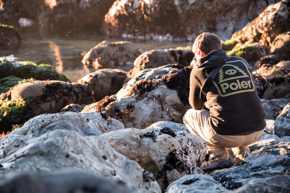 Kim stays warm in her Poler shirt, while photoing from the slippery rocks.