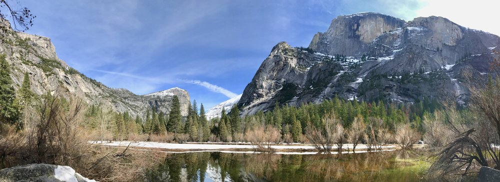 From the left: Basket Dome, Mt. Watkins, snowy Clouds Rest in the background, Ahwiyah Peak, and Half Dome. (Thanks to @yosemitenps on Twitter for helping with the identification of these landmarks!)