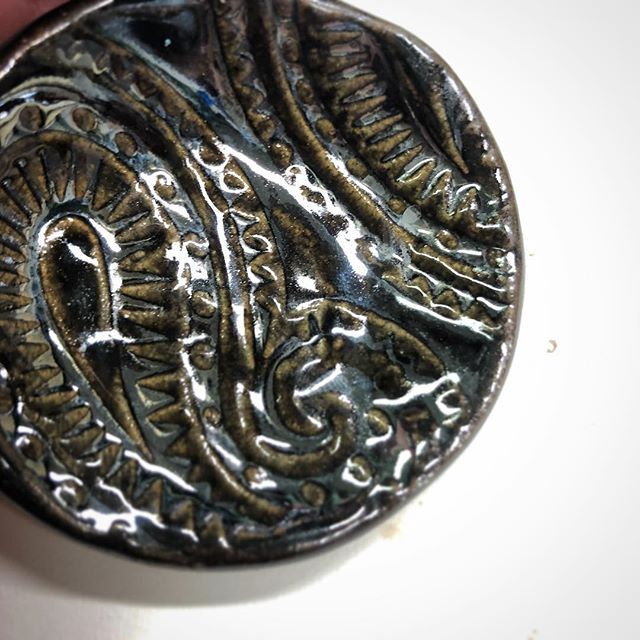#marchmeetthemaker | day 5 - detail or close up.  This is a very very close up shot of my chrome paisley mini ring dish. Hard to shoot this with how shiny the glaze is, but I love the detail in this texture.